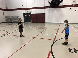 Two boys play jump rope.